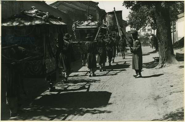 The bridal palanquin, part of a wedding procession making its way through the backstreets of Beijing, 1937 (bromide print)
