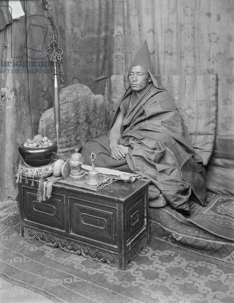 Gelukpa Incarnation Lama with his religious implements, c.1920-21 (glass plate gelatin print)