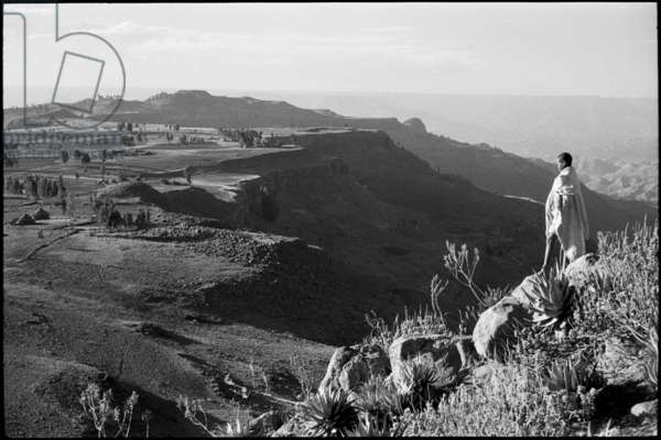 View of an escarpment, looking northwards from Tanta, near Magdala, with a boy standing on rocks in the foreground, Ethiopia, 1960 (b/w photo)
