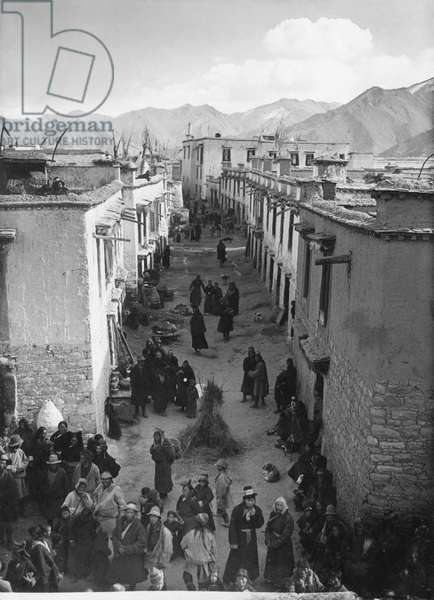 Side street in Lhasa taken from Surkhang Se's house on the occasion of the Palden Lhamo procession, Tibet, 28th November 1936 (gelatin silver print)