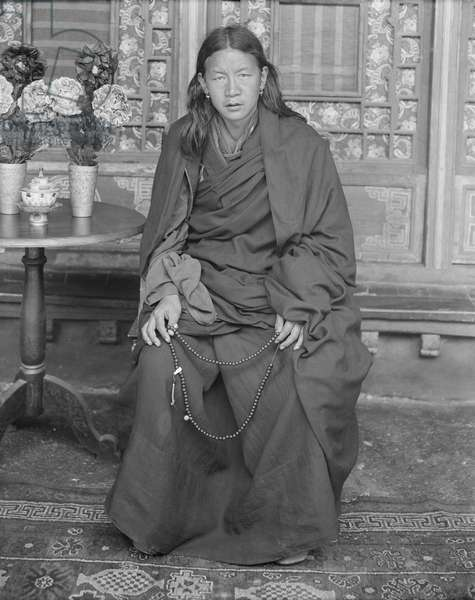 Monk sitting beside table with vase of flowers, c.1920-21 (glass plate gelatin print)