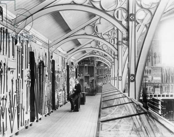 Henry Balfour in a Gallery of the Pitt Rivers Museum, c.1890-5 (b/w photo)