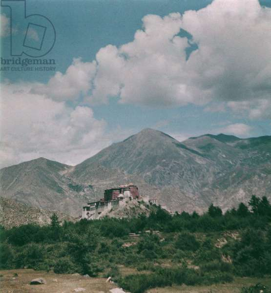 Potala from the west with scrub vegetation in the foreground, Lhasa, Tibet, 1936-50 (colour transparency)