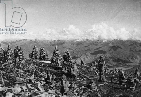 Hugh Richardson at the summit of Gyamberi, the mountain overlooking Drepung Monastery, Lhasa Area, Tibet, 27th September 1936 (gelatin silver print)