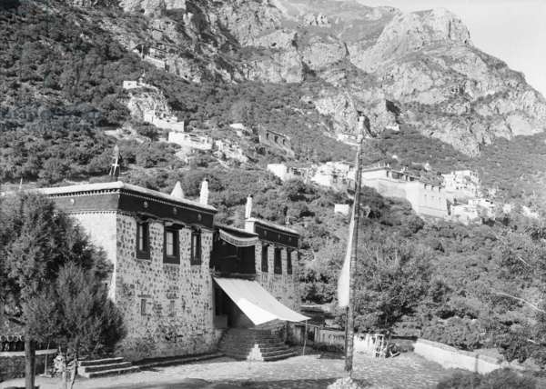 View of Trayerpa monastery buildings on mountain side, 1921 (glass plate gelatin print)