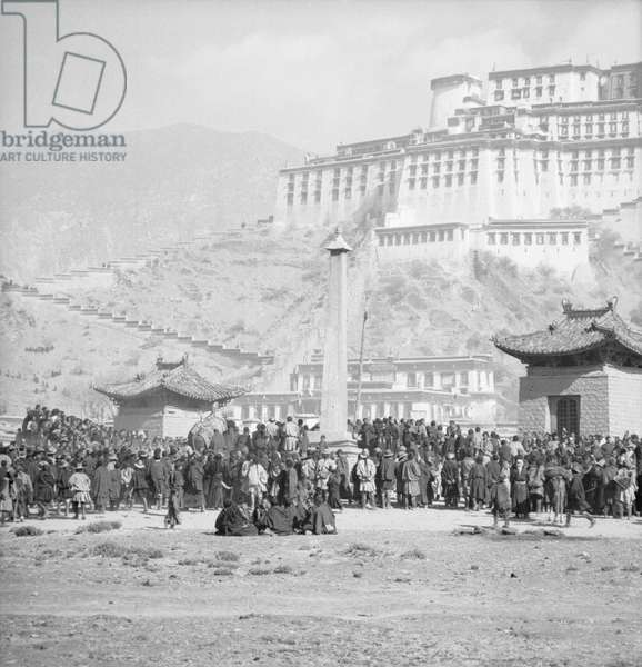 The southern face of the Potala Palace adorned with banners for the Sertreng Ceremony, Lhasa, Tibet, 1949 (b/w photo)