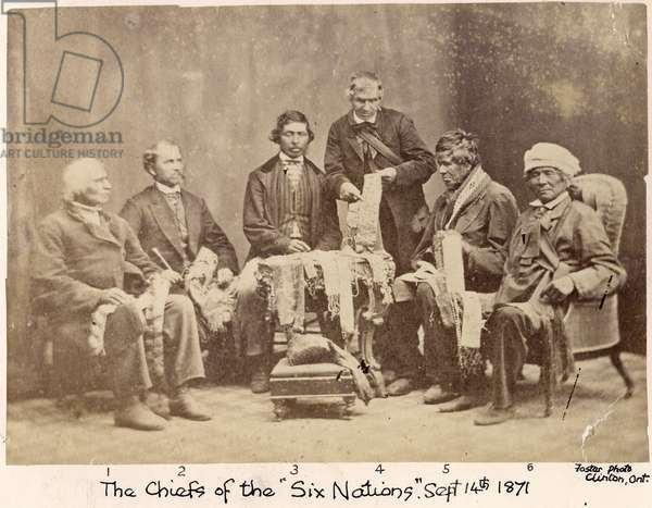 Six of the 50 chiefs of the Six Nations of the Iroquois Explaining Wampum Belts to Horatio Hale, 1871 (albumen print)