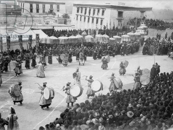 Monks, musicians and spectators at the Sertreng ceremony or 'The Golden Procession of the Assembly of Worship', Sho, Lhasa, Tibet, 1946-50 (b/w photo)