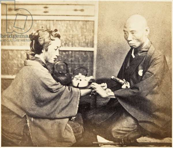 View of Japanese doctor, sitting, wearing traditional dress of kimono with mon (family emblem), in consultation with a female patient, c.1860 (albumen print)