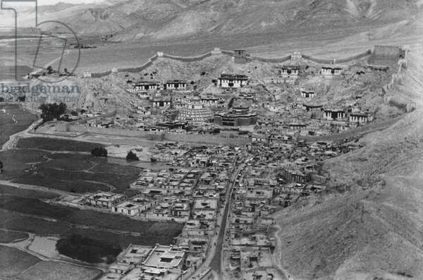 View of Gyantse showing Kumbum, the great chorten and the Palkor Chode Monastery, as seen from the dzong or fort, Tibet, 15th August 1936 (gelatin silver print)