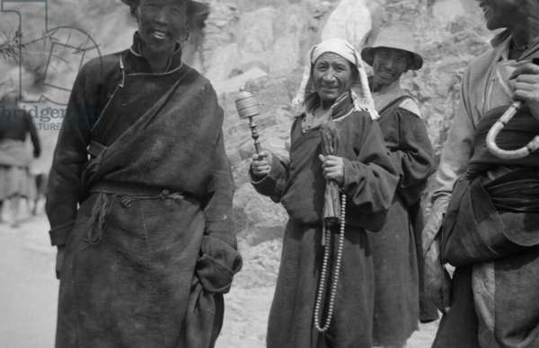 Tibetan people dressed in coats or chuba, Lingkhor, Lhasa, Tibet, 8th September 1936 (b/w photo)