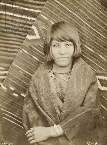 Portrait of a Zuni girl in front of two Zuni blankets, c.1879 (albumen print)