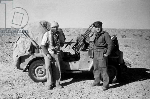 Portrait of Wilfred Thesiger (left) with Colonel Gigantes, Commander of the Greek Sacred Squadron of the Special Air Service (S.A.S.), in the Western Desert, Libya, 1942 (b/w photo)