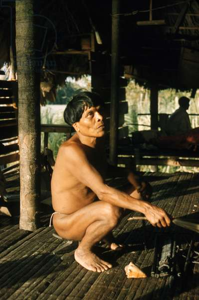 A Noanamá shaman (Severiano) holding a palm frond, San Juan River, Chocó department, Colombia, 1960-61 (photo)