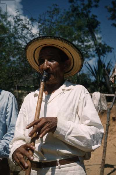 Musician playing flute at the festival of San Isidro, Atanquez, Sierra Nevada de Santa Marta, Cesar department, Colombia, 1960-61 (photo)