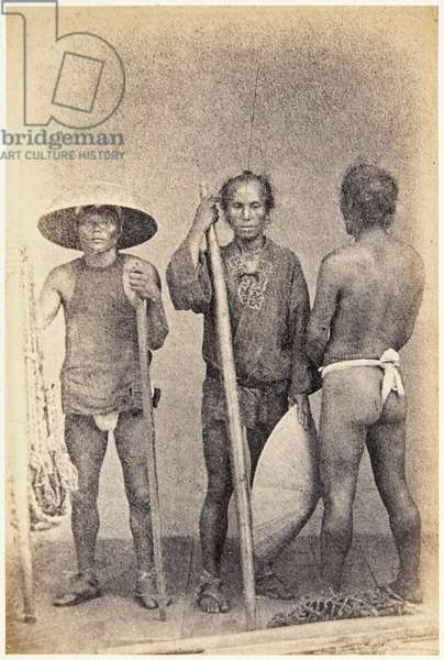 Group portrait of three Japanese men, workers, standing, wearing clothing typical of their trade, c.1860 (albumen print)