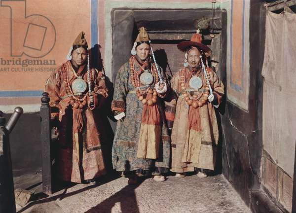 Three officials, Kyibu on the right, wearing ancient Tibetan dress known as ringyen for New Year celebrations, Lhasa, Tibet, 13th February 1937 (colour transparency)