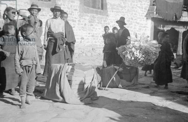 Street in Lhasa near the Barkhor, possibly near one of the entrances to the Jokhang, Lhasa, Tibet, September 1936 (b/w photo)