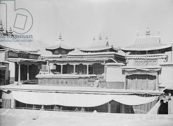 Roof of the Potala Palace with gilt copper pagoda roofs of the tombs of past Dalai Lamas, Lhasa, Tibet, 22nd November 1936 (b/w photo)