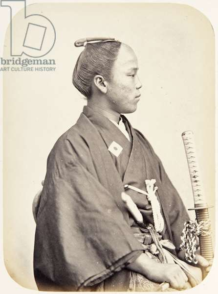 Portrait of a twenty–year–old Japanese man named Saganami Hisashi, a samurai and member of the 1864 Ikeda mission to France, employed as a personal attendant of one of the assistant envoys, 1864 (albumen print)