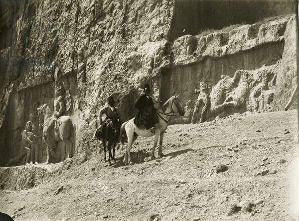 Two horsemen in front of rock reliefs at Naqsh–i Rustam, Iran, c.1900 (gelatin silver print)