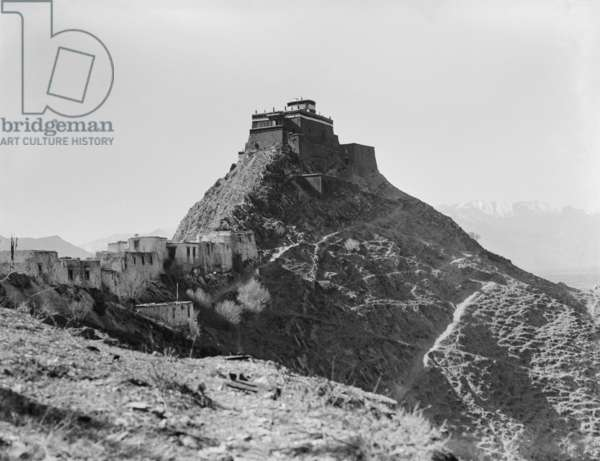 'Iron Hill', or Chakpori, at Lhasa with 'Temple of Medicine' on the summit, c.1920-21 (b/w photo)