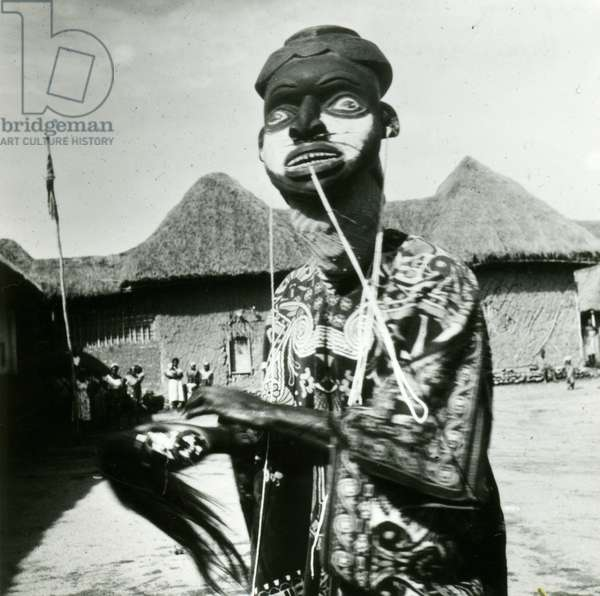 Cameroonian Masked Dancer Representing Tam, the late Fon of Bum, 1960 (b/w photo)