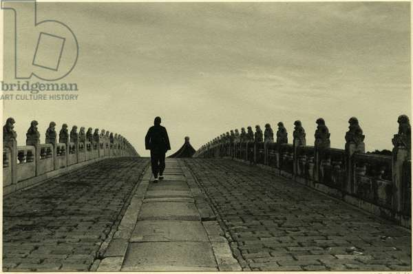 A man crossing the Seventeen–Arch Bridge, connecting the eastern shore of Kunming Lake with Nanhu Island, Beijing, 1937 (bromide print)