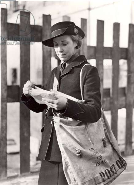 Postwoman delivering in a bombed area during World War II, 1942 (b/w photo)