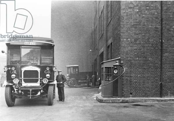 Front view of a Maudsley mail van being filled from a petrol pump, c.1914 (b/w photo)