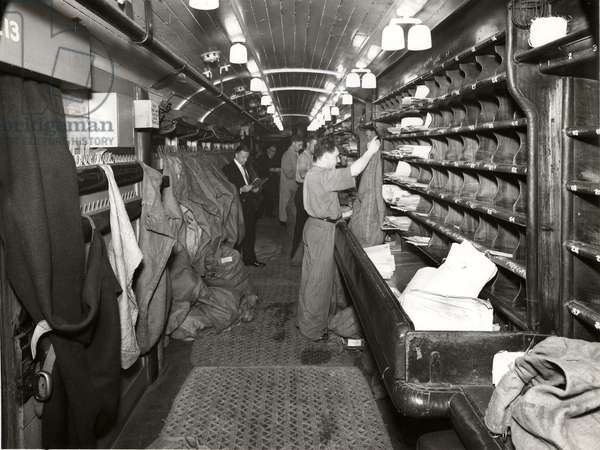 T.P.O. bag and sorting operation, Dawn Special, Euston, London, 1952 (b/w photo)