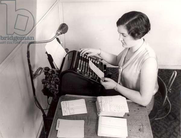 Savings Bank, girl operating an accounting machine, 1934 (b/w photo)