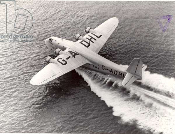 Plane taking off from the water, 1938 (b/w photo)