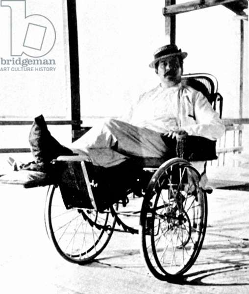 Giacomo Puccini in wheelchair,   Italian composer: 22 December 1858 - 29 November 1924