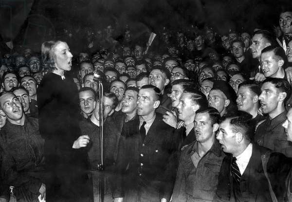 Vera Lynn,  English popular singer,  performing for troops, 1940 (b/w photo)