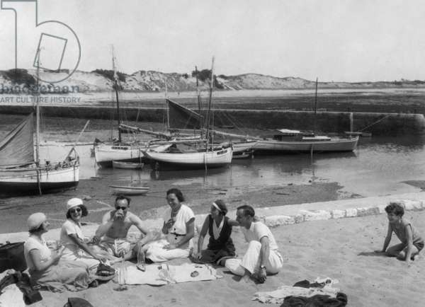 Holiday at seaside: picnic on the beach c. 1930