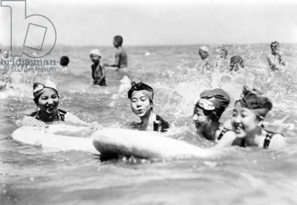 Japanese children at the sea, c. 1920