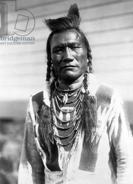 Bird Rattle, Indian man, c. 1910, photo Edward S. Curtis
