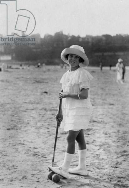 Young girl playing croquet c. 1920