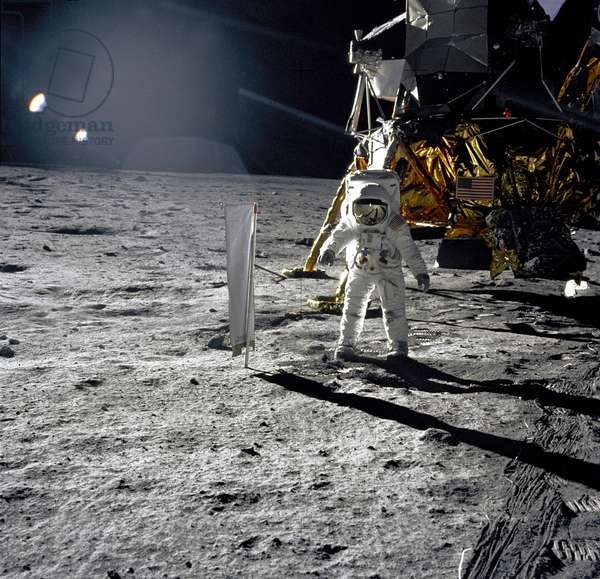 Astronaut Buzz Aldrin, lunar module pilot, walks on the surface of the Moon near the leg of the Lunar Module (LM)