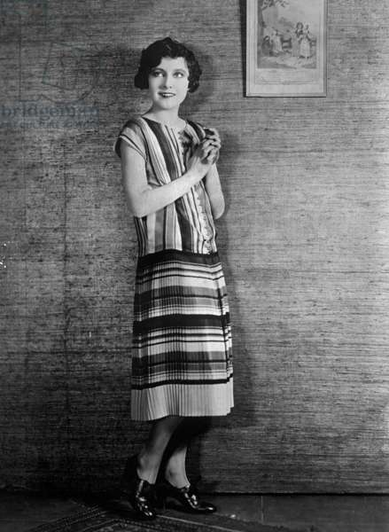 Betty Bronson (1906-1971 Elizabeth Ada Bronson) american actress modeling Roman Stripe Orange, Green, Red & Copper Knit Pleated Skirt with Brass Buttons c; 1925