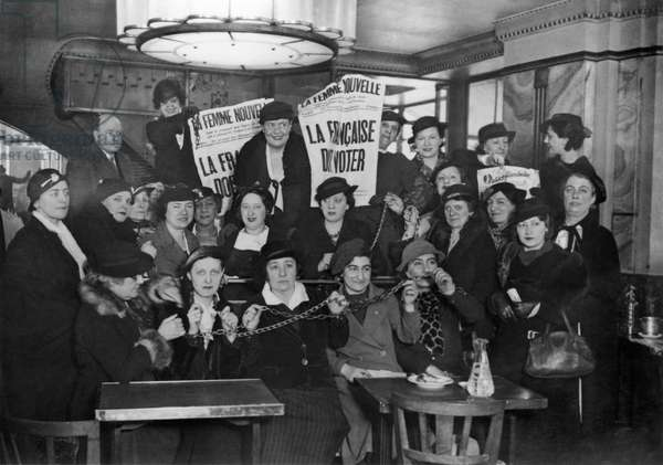 Louise Weiss (3rd up from left) surrounded by activist for women's right to vote in 1936