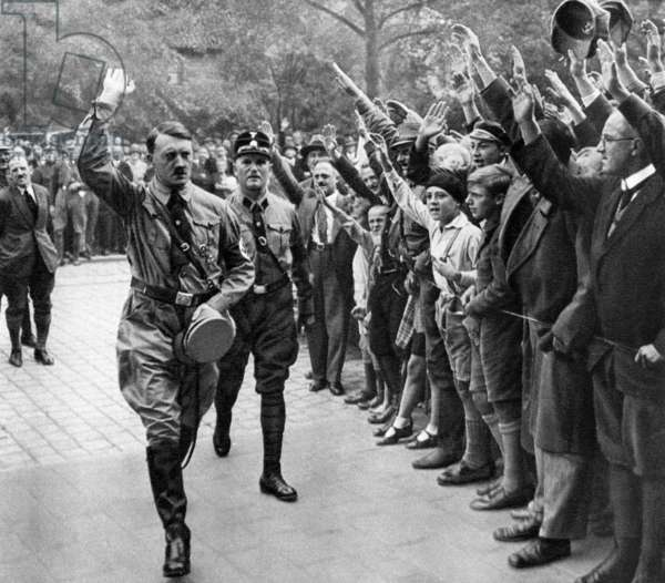Nuremberg Rally (nazi party) in 1929: Adolf Hitler saluted by people making hitlerian salute