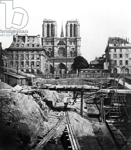 Excavation in Paris c. 1863 on the Cite island (in the background: cathedral Notre Dame de Paris)