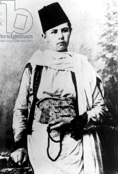 Isabelle Eberhardt (1877-1904) swiss explorer who lived in Algeria in 1897-1904 here wearing arabian costume whiwh is men clothes, c. 1899