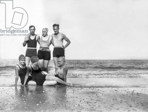 Holidays at the sea: groups of bathers c. 1925