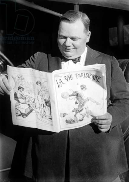 "Roscoe ''Fatty'' Arbuckle (1887-1933) american actor reading french paper ""La Vie Parisienne"" c. 1920"