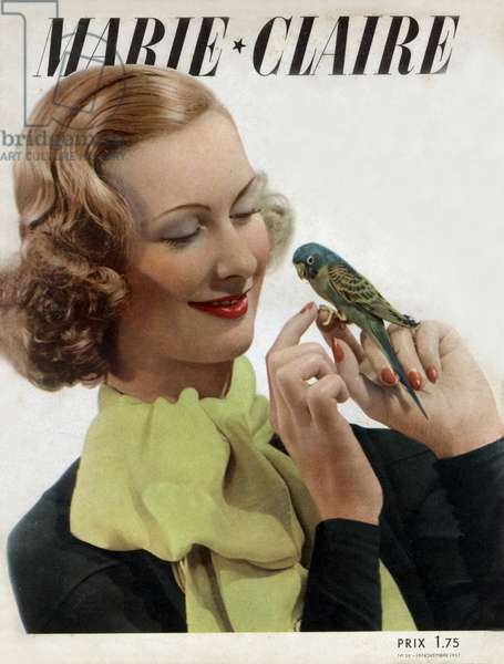 "Cover of french magazine ""Marie Claire"" november 19, 1937: woman with bird"