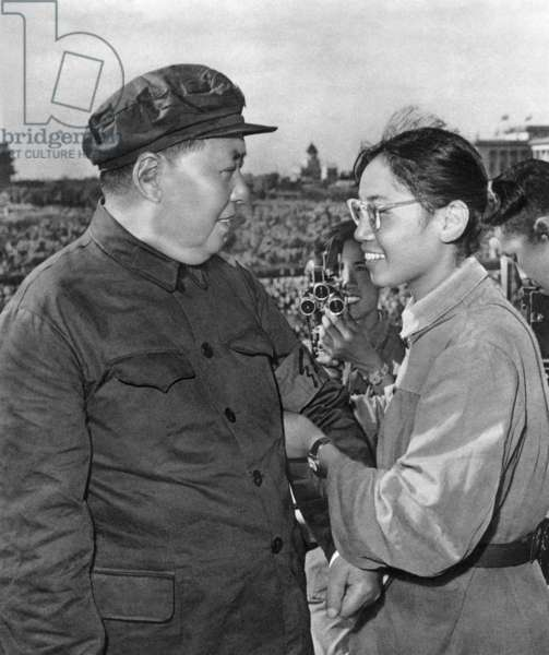 A young woman member of red guard offering to Mao Zedong an armband during a meeting to celebrate the Great Proletarian Cultural Revolution on Tien An Men square in Pekin on august 18, 1966