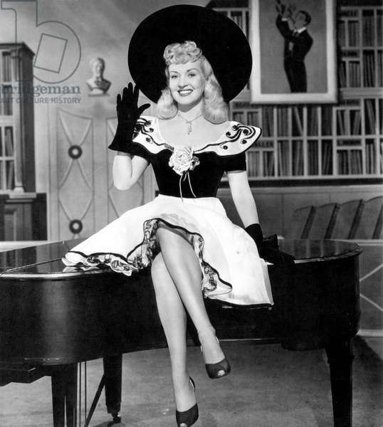 Betty Grable on a grand piano c. 1940